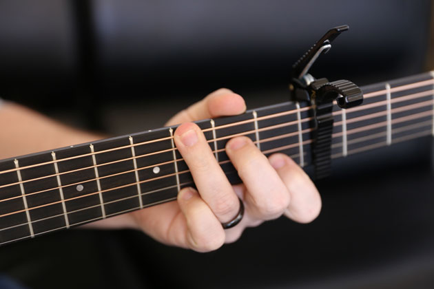 Capo That Mysterious Clamp Explained Blog Chordify Tune Into